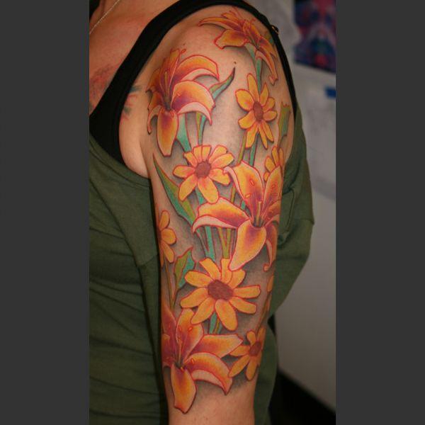 african-daisies-lilies-51716b6e38d3291156dce33bd52dd2c1542e434d